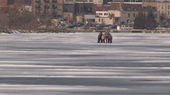 Dangerous thin unsafe ice in with people on it in Barrie Canada - stock footage