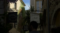 Walking by Joël Guyot and Vladimir Rustinoff art galleries, Saint-Paul-de-Vence Stock Footage