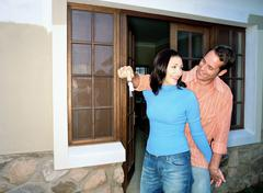 Stock Photo of Couple with keys to new home