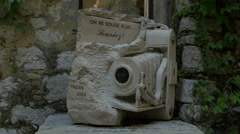 Sculpture camera of pink granite by Luc Trizan in Saint-Paul-de-Vence Stock Footage