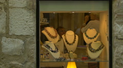 Necklaces displayed in a storefront of a jewelry store in Saint-Paul-de-Vence - stock footage