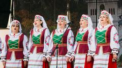 Stock Photo of Unknown women group in national clothes perform folk songs in Go