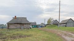Dilapidated old wooden houses in the countryside Stock Photos