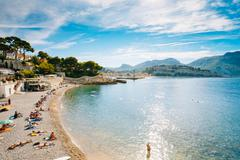 People resting at beach in Cassis, France Stock Photos