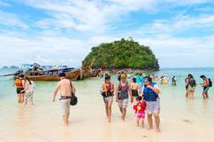 Many tourists on the beach at Tup Island Krabi, Thailand - stock photo