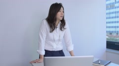 Japanese businesswoman doing a presentation in a modern office Stock Footage