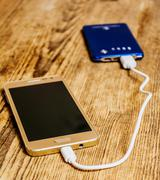 Mobile phone charging - stock photo