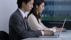Japanese businesspeople working in a modern office Stock Footage