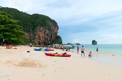 Tourists relaxing on popular Railay Pranang beach Stock Photos