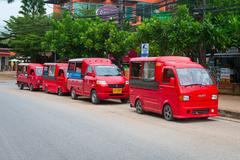 Four red taxis parked in the street. Stock Photos