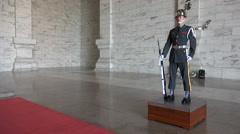 A Taiwanese soldier stands guard at the Chiang Kai-shek memorial hall in Taipei Stock Footage