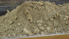 Loading soil on a dump truck. Close up, Stock Footage