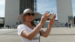 Beautiful girl taking a selfie next to  Business centre La Defense Stock Footage