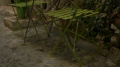 Green chairs and table outside a small restaurant in Saint-Paul-de-Vence Stock Footage
