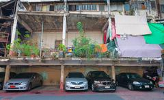 Cars Parked beneath an Old, but Unfinished Building in Bangkok Stock Photos