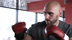 Boxer training with punching bag - stock footage