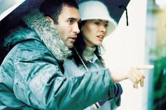Couple under umbrella Stock Photos