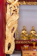 Ornate and intricate, hand carved, gold framework on an altar at Canton Shrin Stock Photos
