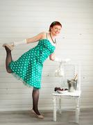 Attractive adult woman wearing spotted green dress - stock photo