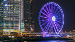 Skycrapers night timelapse and Hong Kong Observation Wheel, which is the latest Stock Footage