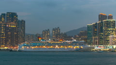 Shyline panorama timelapse day to night with towers and cruise liner in West - stock footage