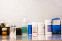 Blurred image of medical drugs - stock photo