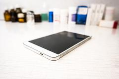 Tablet pc with medical objects - stock photo