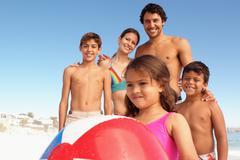 A family on a beach - stock photo