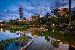 Taipei 101 and a lake at Zhongshan Park at night, in Xinyi, Taipei, Taiwan Stock Photos