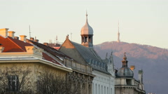 View of a bell tower, a dome and an antenna on a hill, Zagreb - stock footage