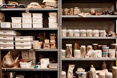 Metal workshop shelves with variety of containers arranged neatl Stock Photos
