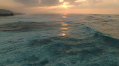 flight over of ocean sunset. Aerial shot of Ocean waves - Hawaii - stock footage
