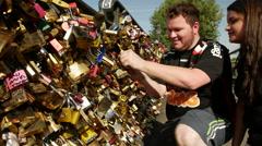 Putting a special locker on Pont des arts bridge in Paris. Stock Footage
