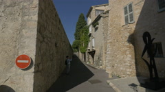 Taking pictures of the buildings on Courtine Sainte-Anne, Saint-Paul-de-Vence Stock Footage
