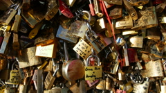 Girl placing a love lock on the Pont des Arts Bridge. Stock Footage