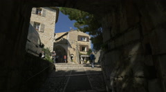 People taking pictures in front of the entrance gate of Saint-Paul-de-Vence Stock Footage