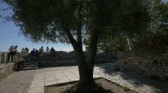Tourists admiring the surroundings from a small square at Saint-Paul-de-Vence Stock Footage