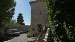 Women talking near the art galleries at the gate of Saint-Paul-de-Vence Stock Footage