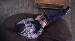 The man lies on a chair and buy online Stock Footage