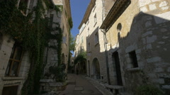 Tourists walking next to the M.J.B. Gallery in Saint-Paul-de-Vence Stock Footage