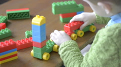 Boy playing constructor Stock Footage