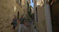 Walking on Rue Grande, passing by Couleur d'Eté store in Saint-Paul-de-Vence Stock Footage