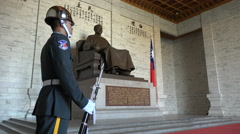 A soldier standing guard in front of a statue of Chiang Kai-shek in Taipei Stock Footage