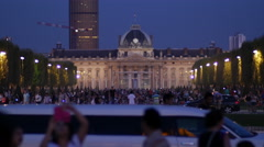 Tourists in Paris, with the The Ecole Militaire on the background. Stock Footage