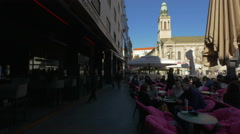 People relaxing at an outdoor cafe in Cvjetni square, Zagreb, Croatia Stock Footage