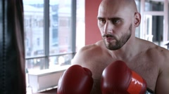 Boxer itraining in gym with punching bag - stock footage