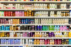 Shampoo Bottles For Sale On Supermarket Stand Stock Photos