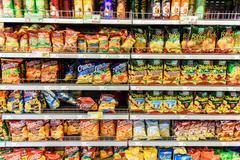 Fast Food Snacks For Sale On Supermarket Shelf - stock photo