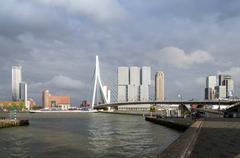 Erasmus Bridge with Skyscraper in Rotterdam - stock photo
