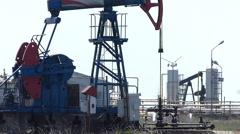 Oil Pump Jack in a Field - stock footage